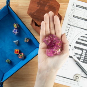Fuchsia and Gold Dice in hand