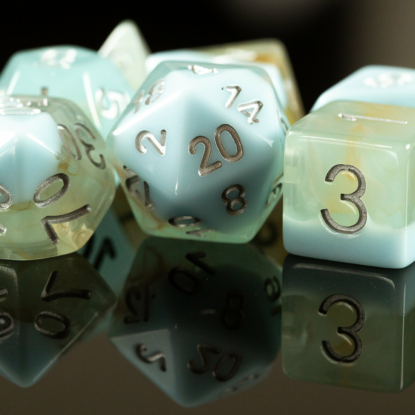 One thin solid blue line with a light blue injected with brown nebula dice set with silver ink